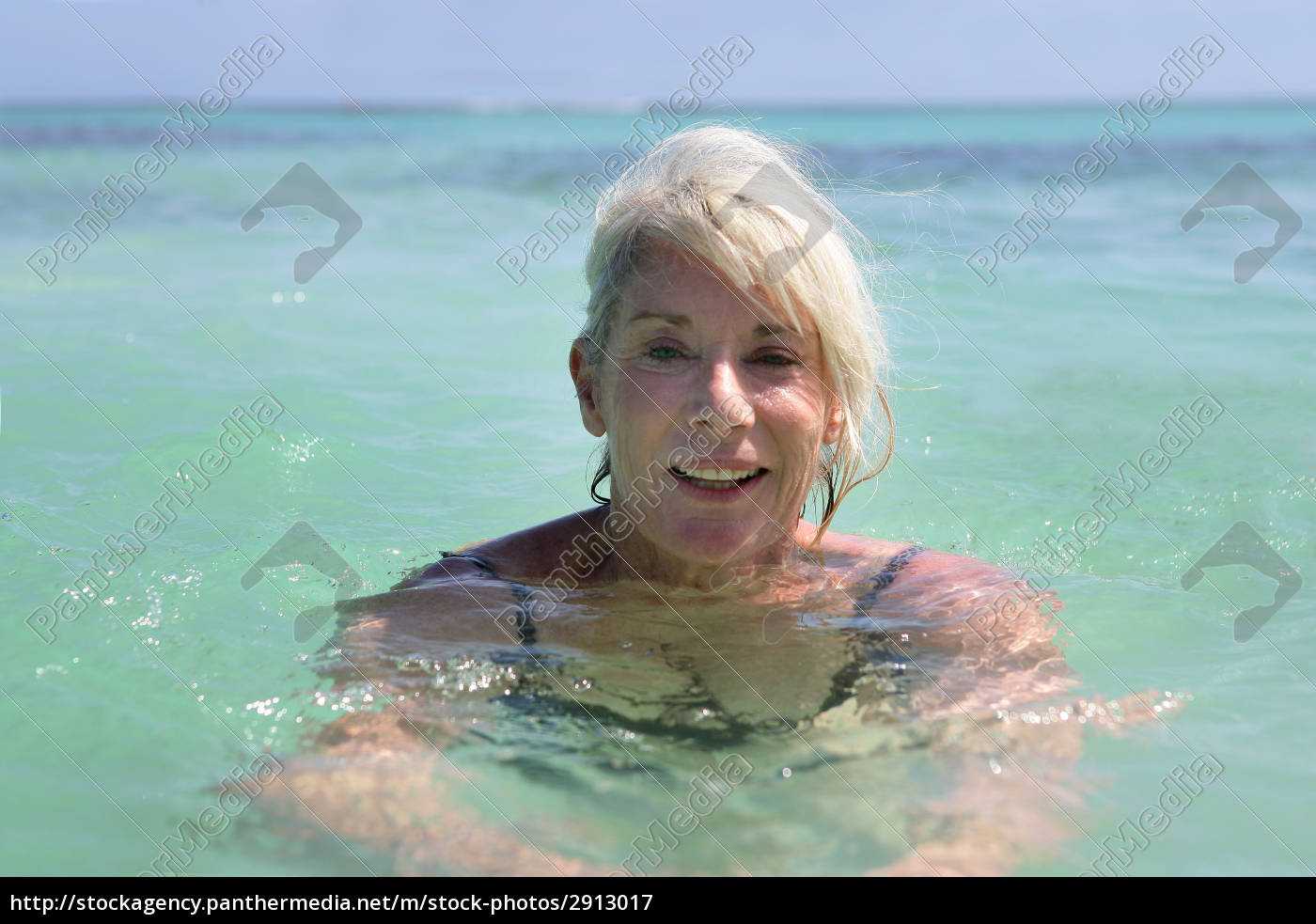 smiling, elderly, woman, bathing, in, the - 2913017