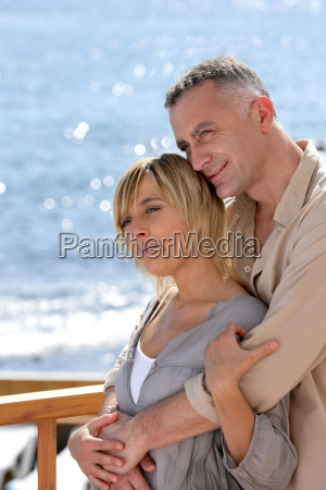 couple, hugging, on, the, sea, terrace - 2914911