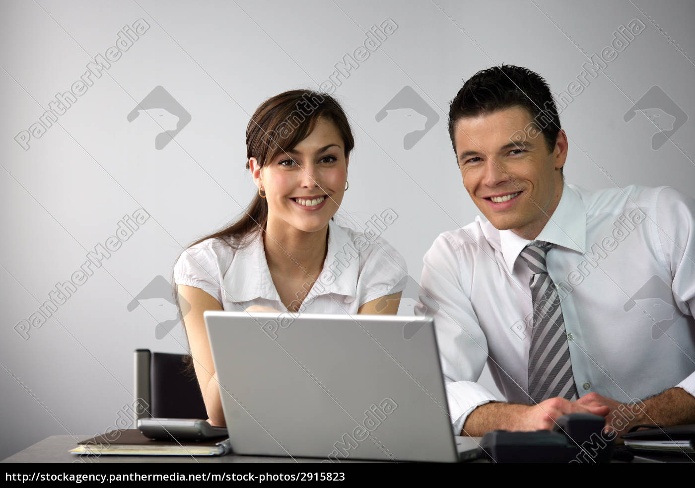 man, and, woman, smiling, with, laptop - 2915823
