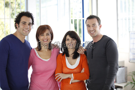 portrait of men and women smiling