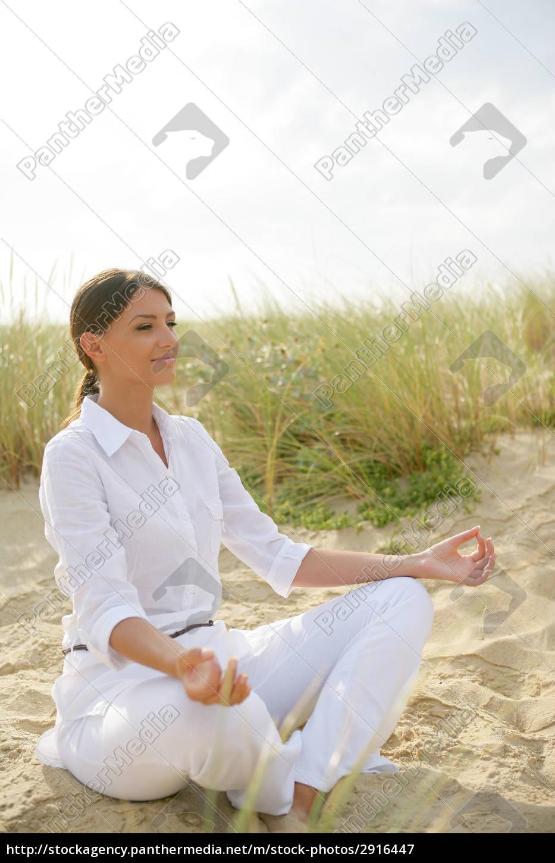 portrait, of, woman, meditating, sitting, on - 2916447