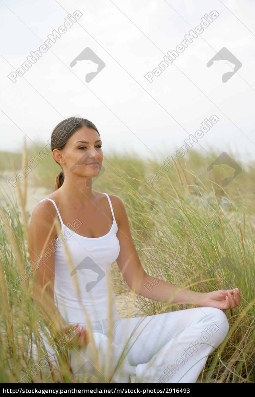 portrait, of, woman, meditating, sitting, on - 2916493