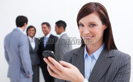 confident businesswoman writing a text with