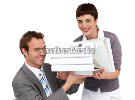 smiling businesswoman bringing a stack of
