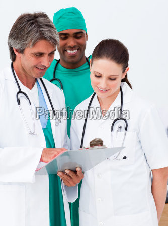 medical team studying a medical history