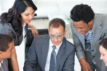 manager working with businessteam in office