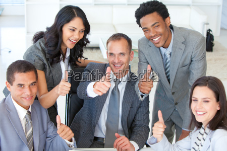 happy businessteam with thumbs up in