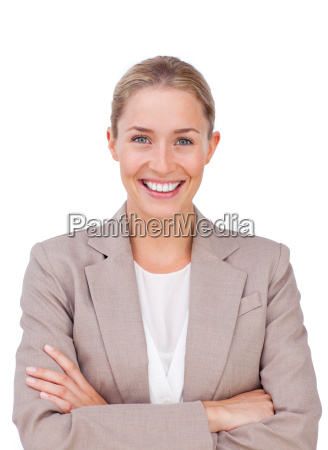 radiant female executive with folded arms
