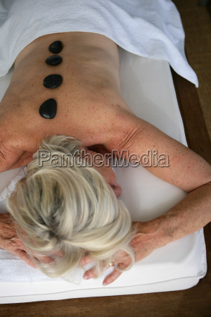 black pebbles placed on the backs