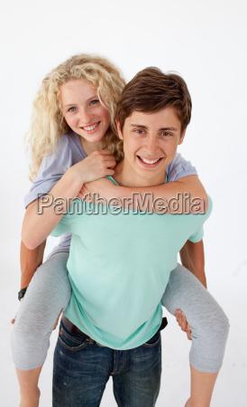 teen guy giving a friend piggyback