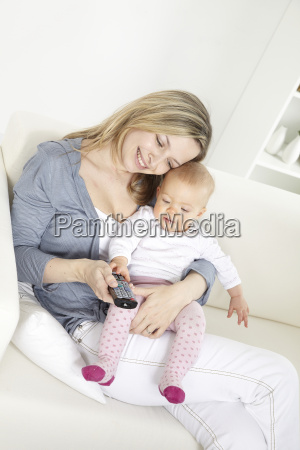 young, mother, with, baby, on, white - 2982655