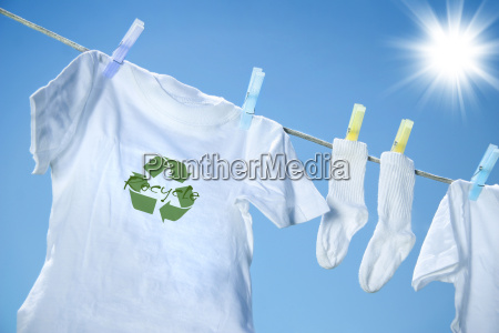t shirt with recycle logo drying