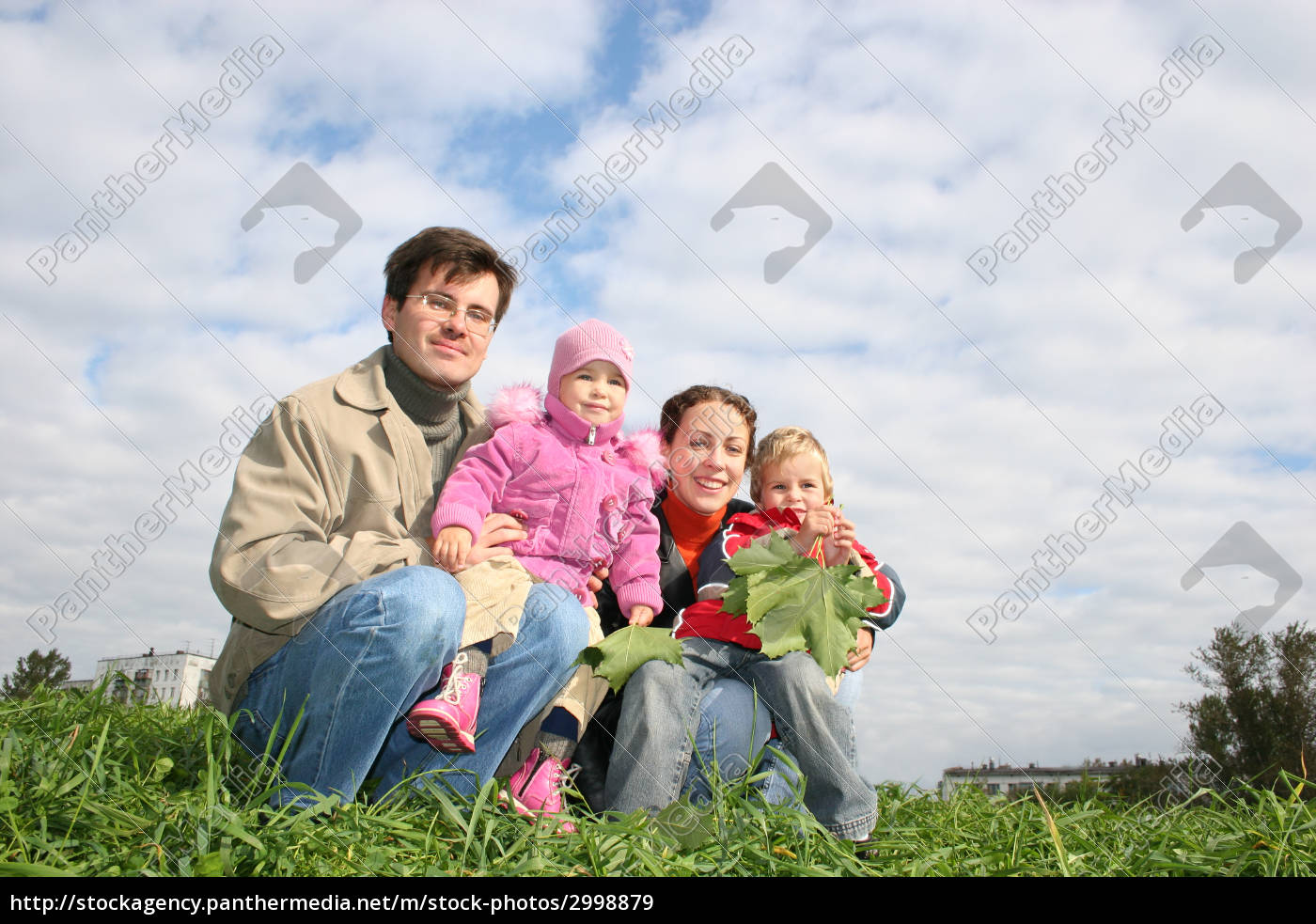 family, of, four, sit., clouds., grass - 2998879