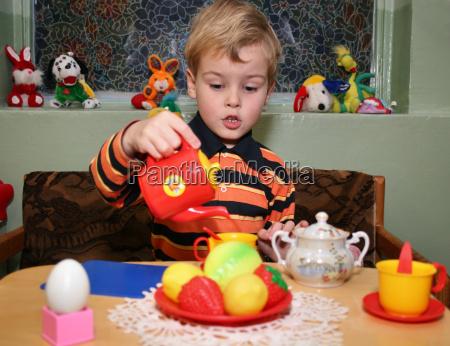 child play tea in kindergarten