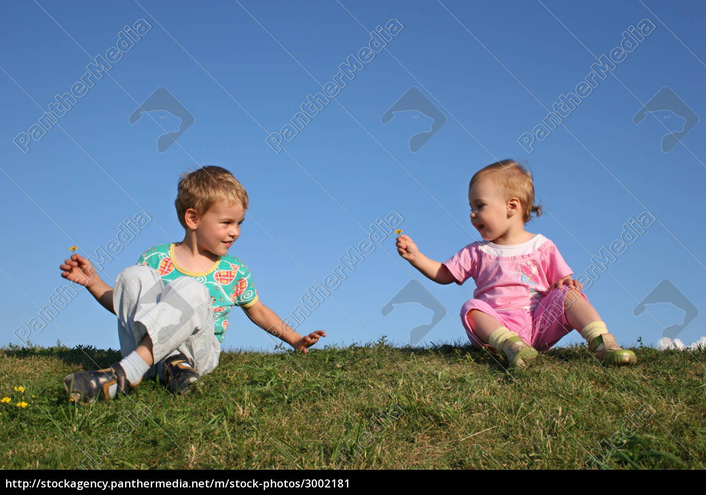 children, on, grass, with, flowers - 3002181