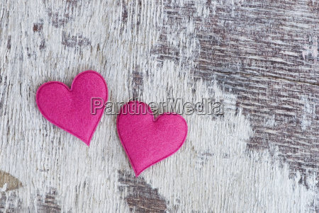 felt hearts on wood