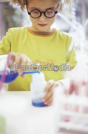 girl 8 9 in chemical lab