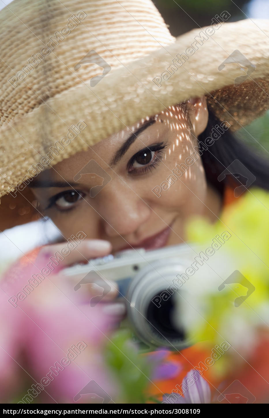 young, woman, taking, pictures, of, flowers - 3008109