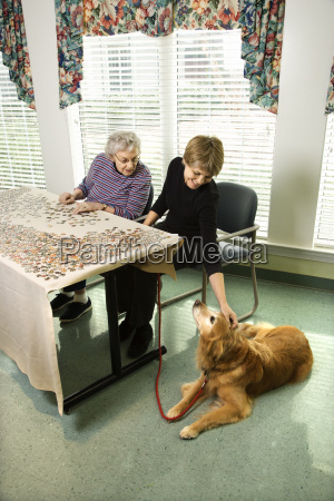 two women with dog