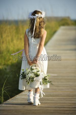 flower girl on boardwalk