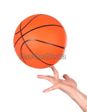 hands making balancing with a basketball