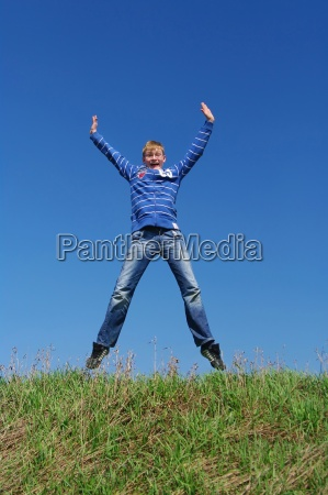 teenagers jumping in the air with