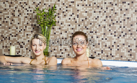 two, young, women, in, hot, tub - 3025930