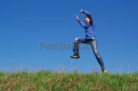 teenager jumping for joy and runs
