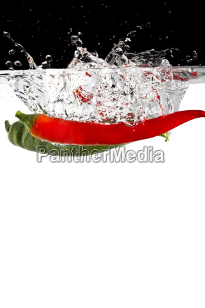red and green hot peppers in