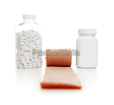 bottles of pills and bandage wrap