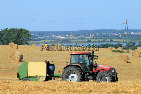 landscape, with, tractor, and, straw, bales - 3061031