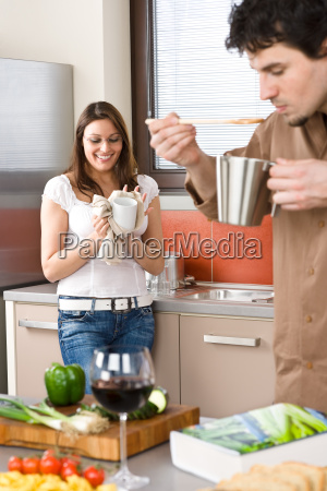 happy, couple, in, modern, kitchen, cooking - 3063807