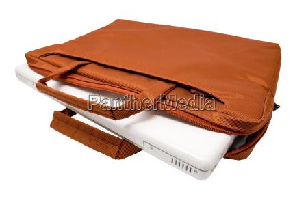 orange bag and white laptop