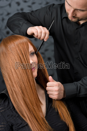 professional hairdresser with fashion model at