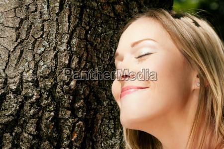 woman embraces tree environmental protection