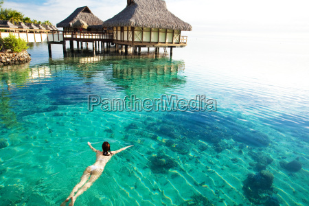young, woman, swimming, in, a, coral - 3082727