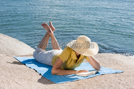 woman reading a book by the