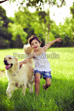 young, girl, with, golden, retriever, running - 3090195
