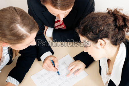 business people working on a spread