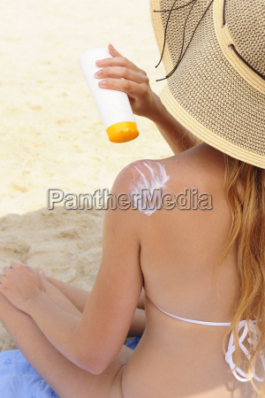 woman is creamed with suncream