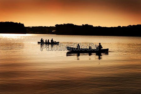 silhouette, of, canoers, on, lake - 3117479