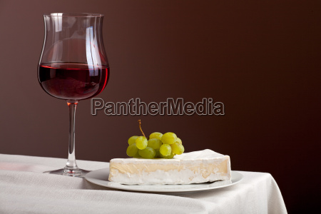 glass of red wine and camembert