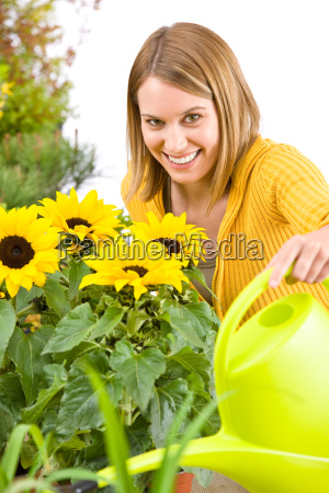 gardening woman pouring water to