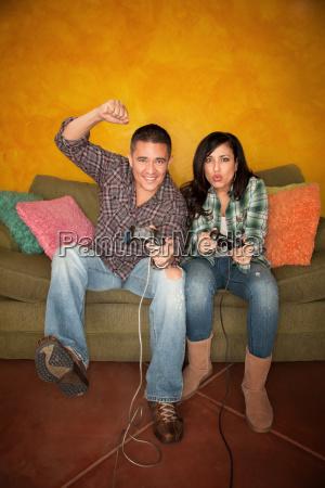 attractive, hispanic, couple, playing, a, vid - 3132039
