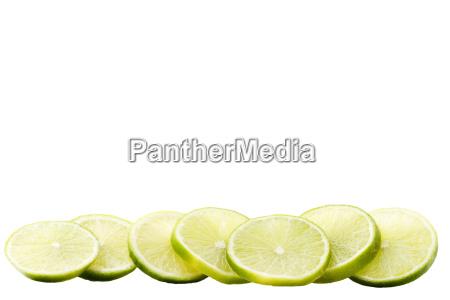 a row lime slices