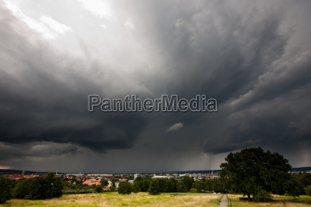 storm over a city in summer
