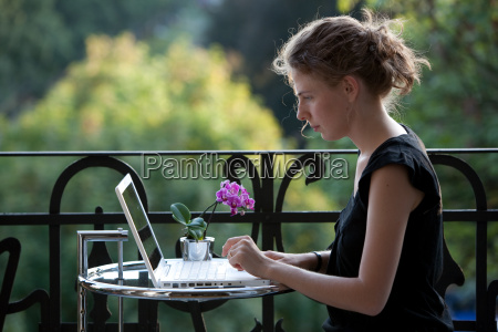 young woman working on laptop on
