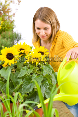 gardening woman pouring flowers