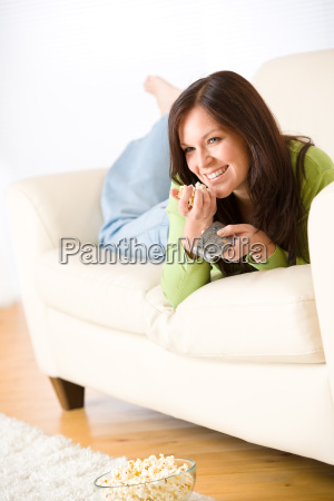 woman, watching, television, with, popcorn, in - 3146265