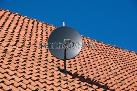 satellite dish on old roof
